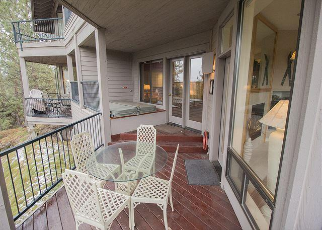 Back deck with patio furniture and a hot tub