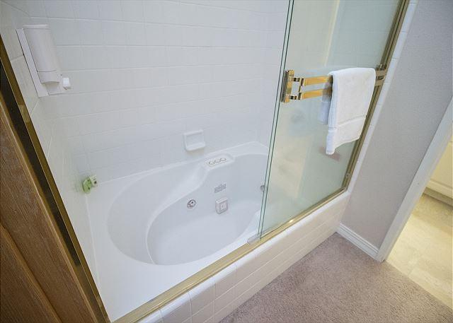 Large, jetted tub and shower in the king master suite