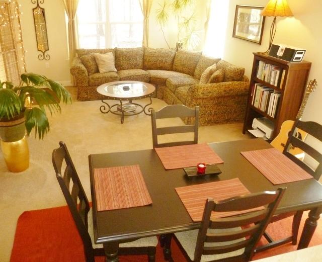 Spacious dining and sitting area.  Television has been moved into this room in front of the sofa.