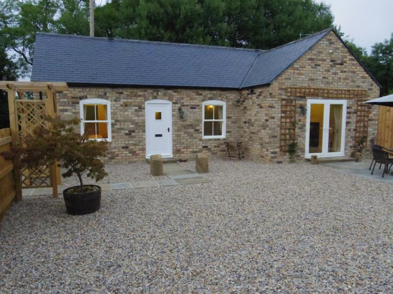 Front of cottage with enclosed garden and patio area
