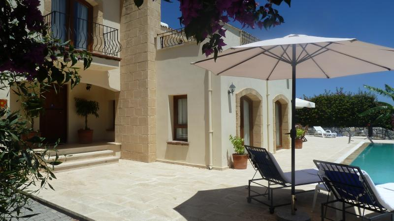 Villa showing extensive pool terraces for Dining and relaxing. Level access between pool and lounge