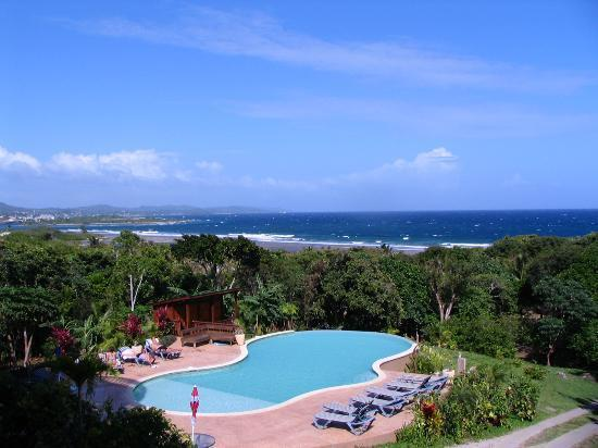View of pool and sea
