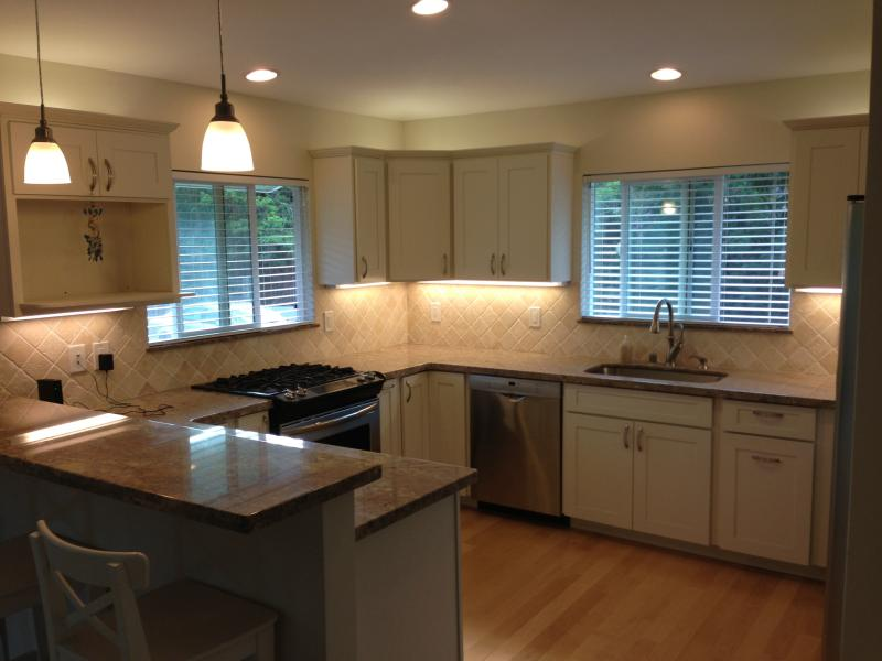 Gourmet kitchen with gas range, dishwasher, 3 seat bar, and granite countertops