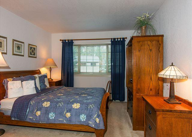 Queen size bed in private master bedroom with great style.
