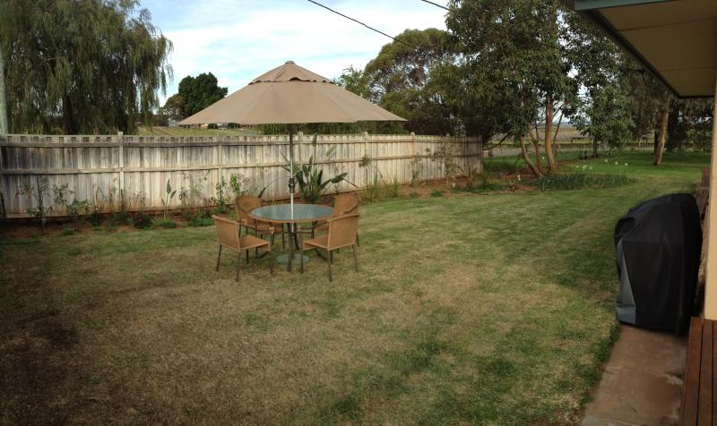 Outdoor seating with private garden and BBQ