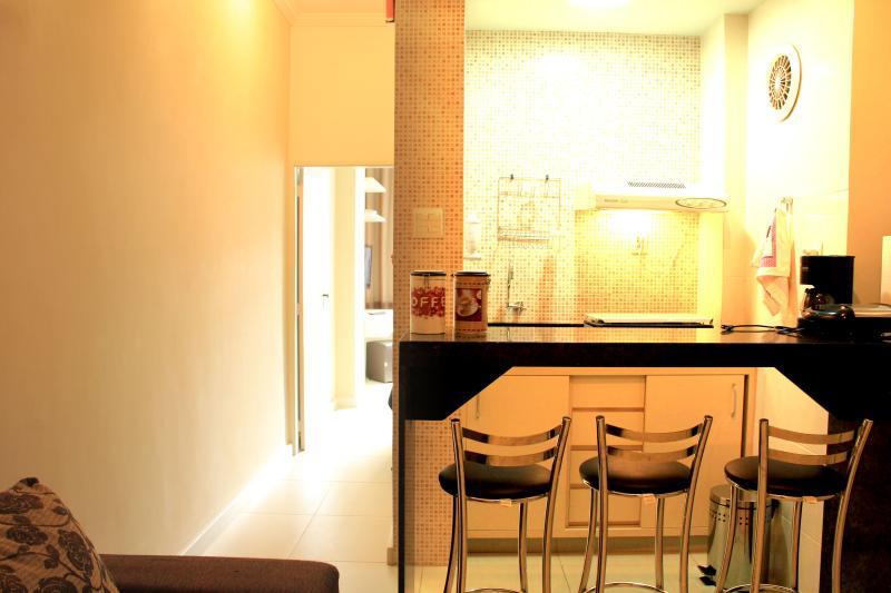 Sala e a cozinha americana