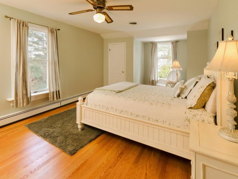 Queen bedroom with attached baby crib annex room