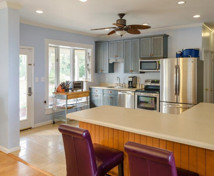 Modern open kitchen with island seating 4