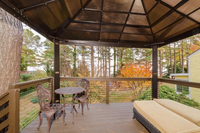 Carriage House has elevated covered deck with mosquito netting and great views
