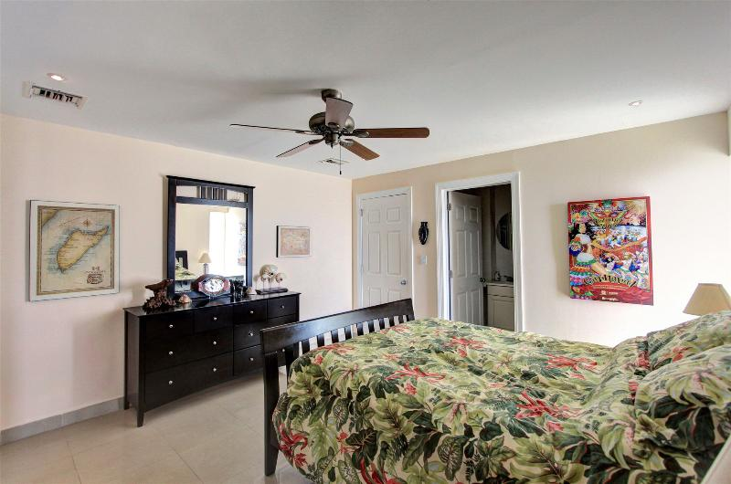 large second bedroom separated from master by hallway makes for privacy