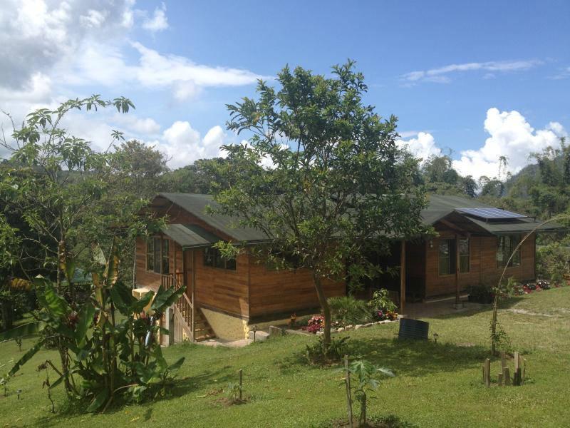 Front view of solar powered eco-house surrounded by mountain views, countryside & gardens!