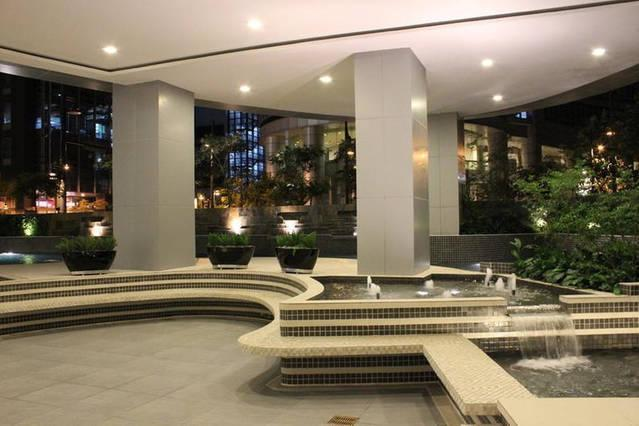 Poolside area with koi pond at night