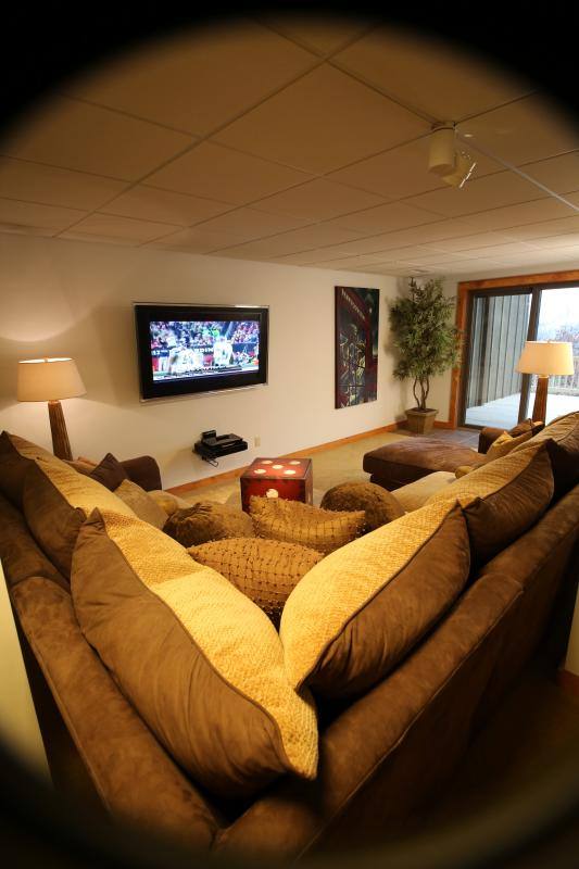 Entertainment Lounge with Bar, 65' Flat Screen TV, DVD, opening out to huge deck with sun loungers.