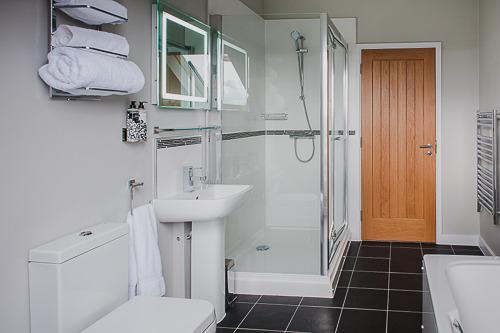 The main bathroom with bath and shower