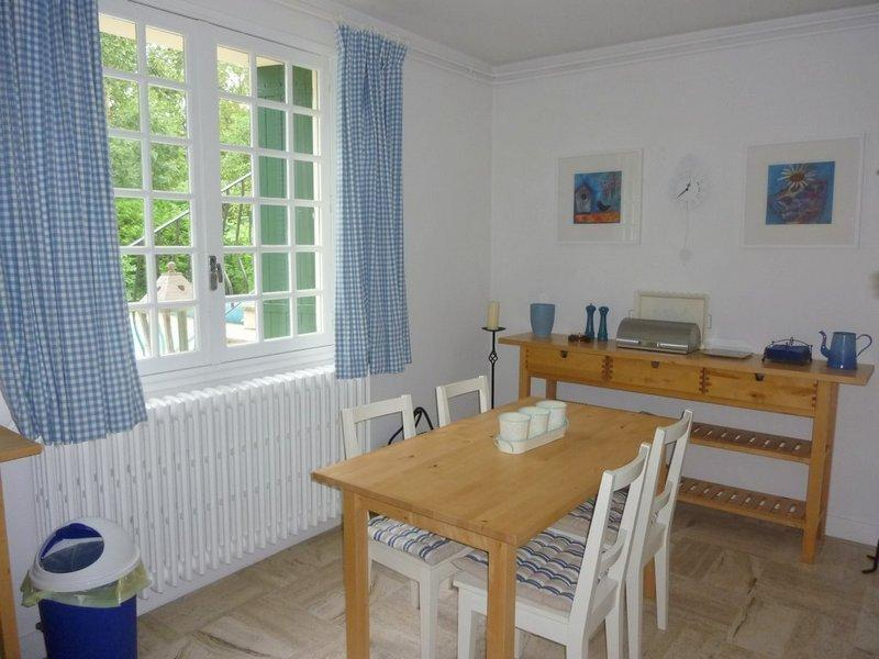 Apartment kitchen/dining area - gives directly onto the pool, doubles as a summer kitchen