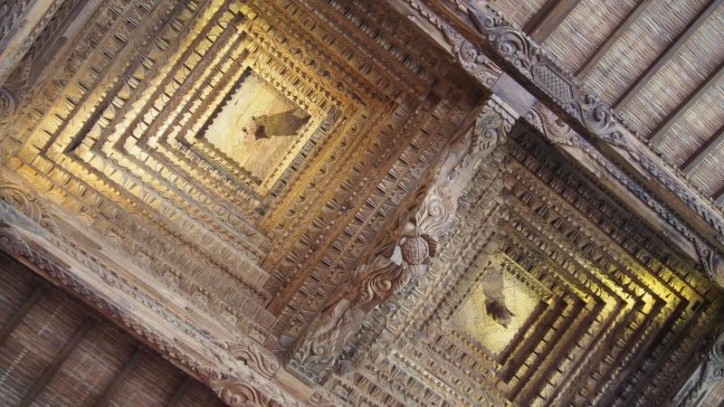 Carved timber ceiling in living area.