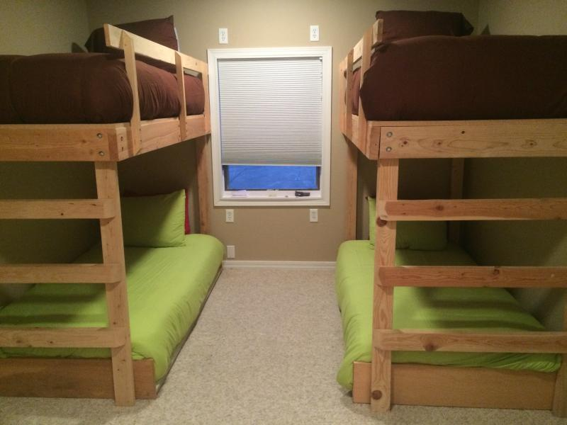 main floor room has 4 bunk beds with a full bathroom next to it