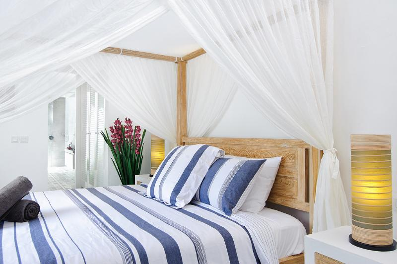 Mosquito nets over bed