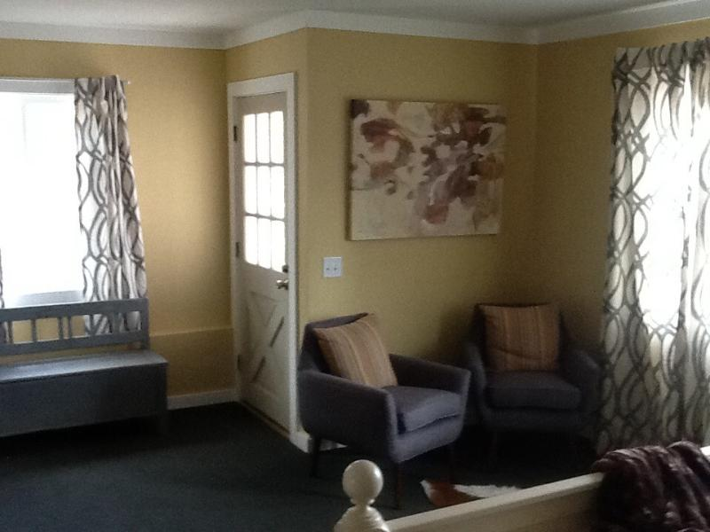 Sitting area in bedroom with plenty of space.