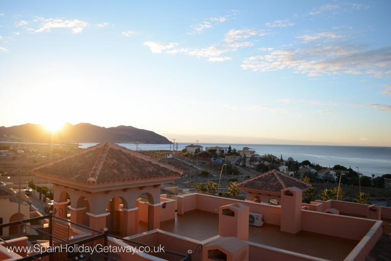 Unobstructed views of the mountains and sea from the large roof-top terrace patio