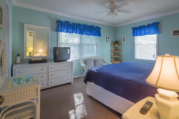 Master bedroom has king bed