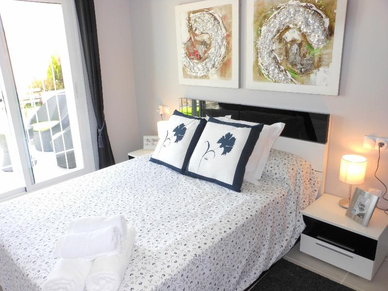 Air-conditioned double bedroom with ensuite shower room and access to the balcony