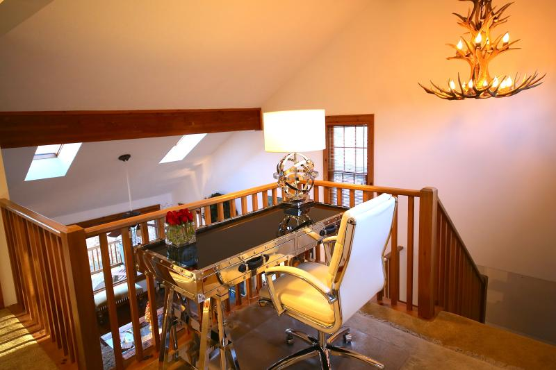A desk in the gallery with complimentary WiFi through out the property.