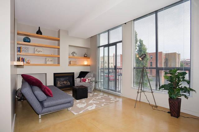 living room faces south-loads of sun exposure and a cozy gas fireplace