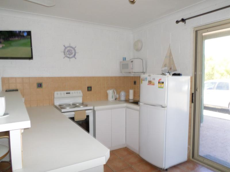 Full kitchen with stove and oven, microwave, fridge, pantry (some essentials for your use)