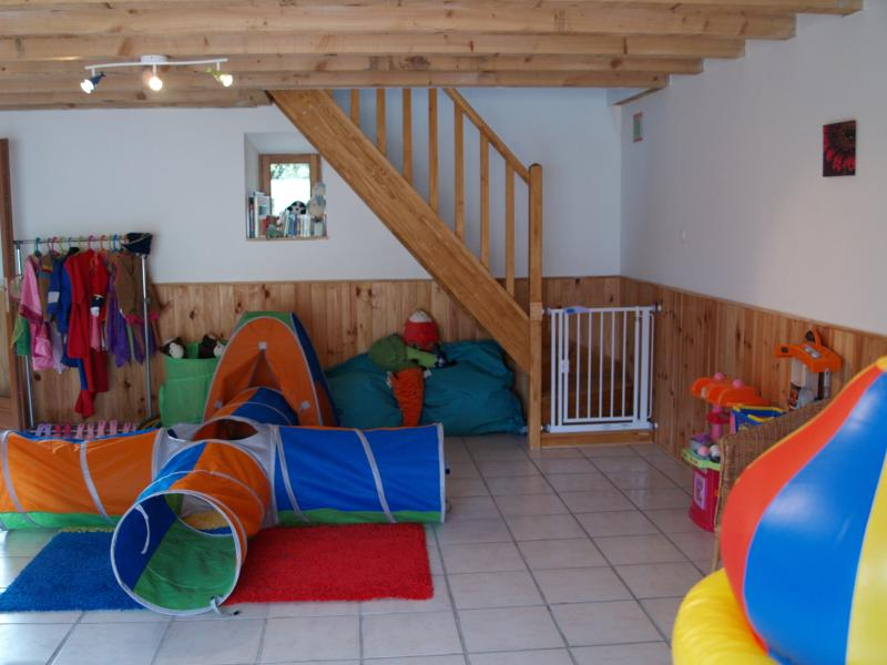 The play barn with dressing up box and bouncy castle