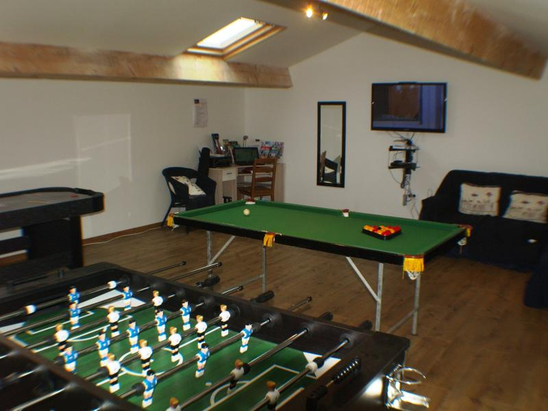 The games room with table games and a wii