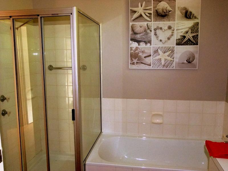 Spacious bathroom with shower and bath!