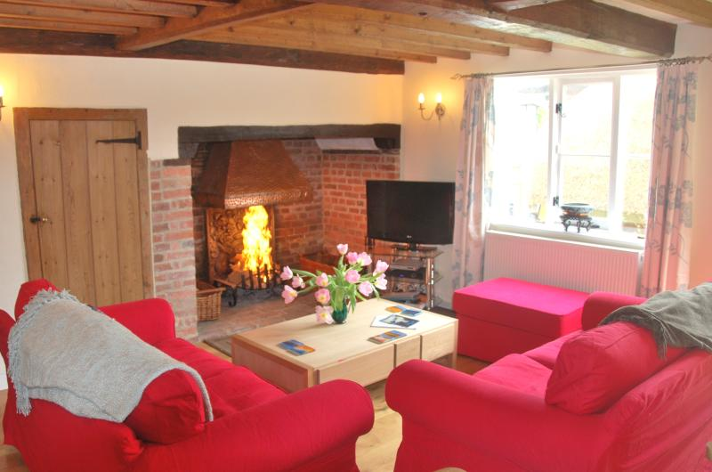 Enjoy cool evenings by the inglenook fireplace
