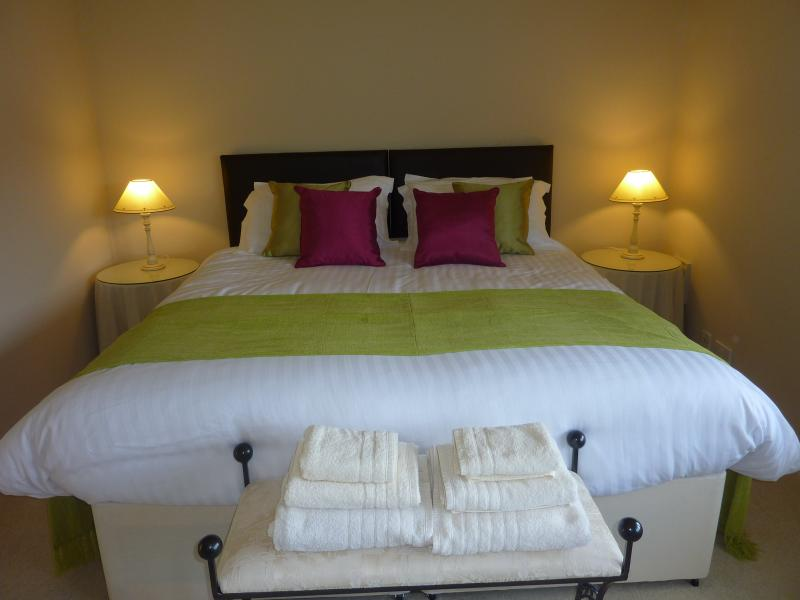 Hotel quality Super Kingsize bed in the spacious bedroom.