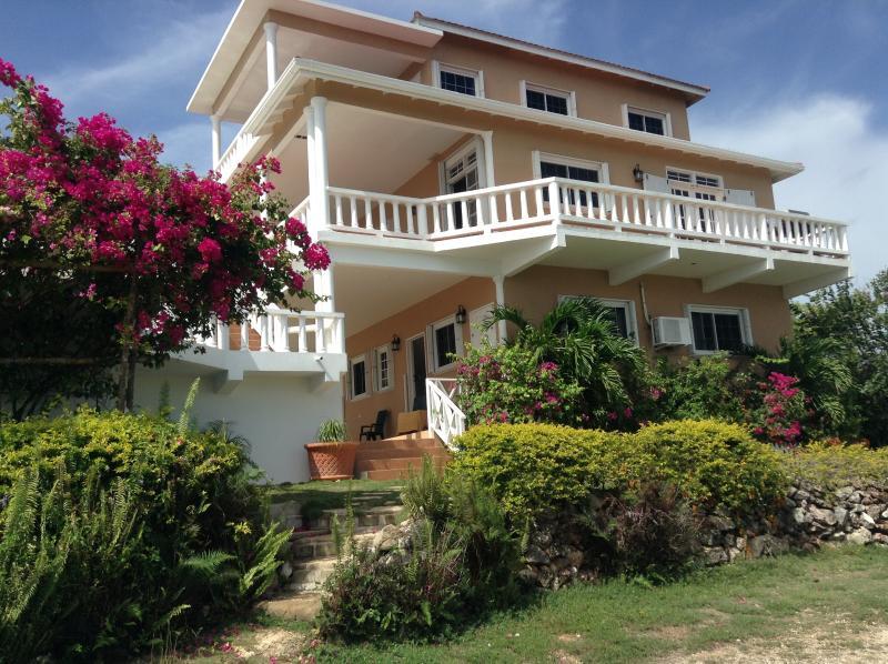 Lush vegetation waits you around the three story villa. With views from two verandas.