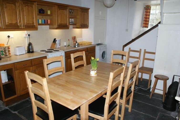 The kitchen has an electric hob and oven, dishwasher, fridge freezer, washing machine & tumble dryer