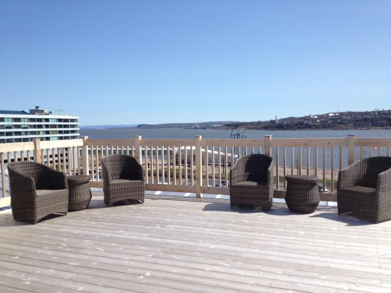 Roof top patio for use by our guest.  View of the St Lawrence and the Chateau.