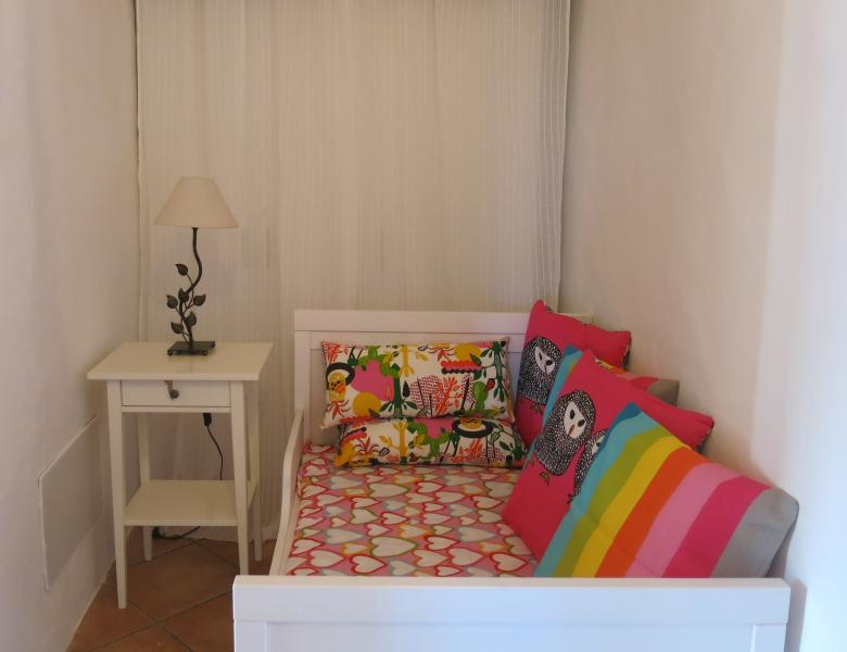 The L-shape of the master bedroom enables a small area for a child's bed tucked around the corner