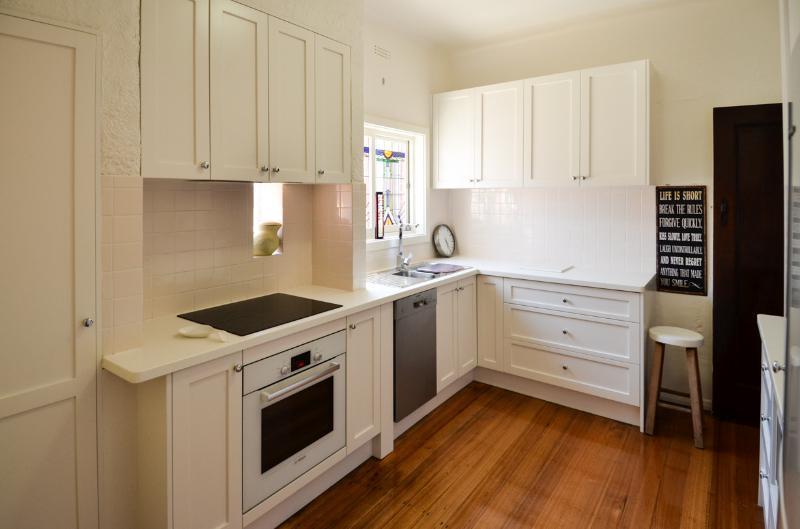 Fully equipped, designer kitchen with easy clean induction cooktop. Underbench dishwasher too.