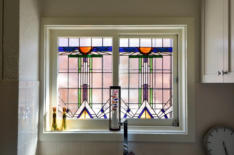 Stained glass window in kitchen adds charm.