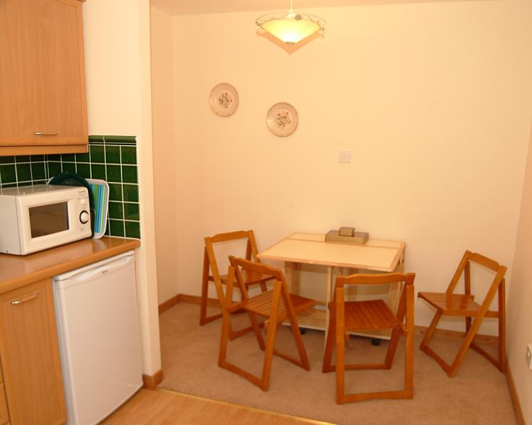 Fully fitted kitchen with dining area, microwave, oven, fridge, freezer, washing machine
