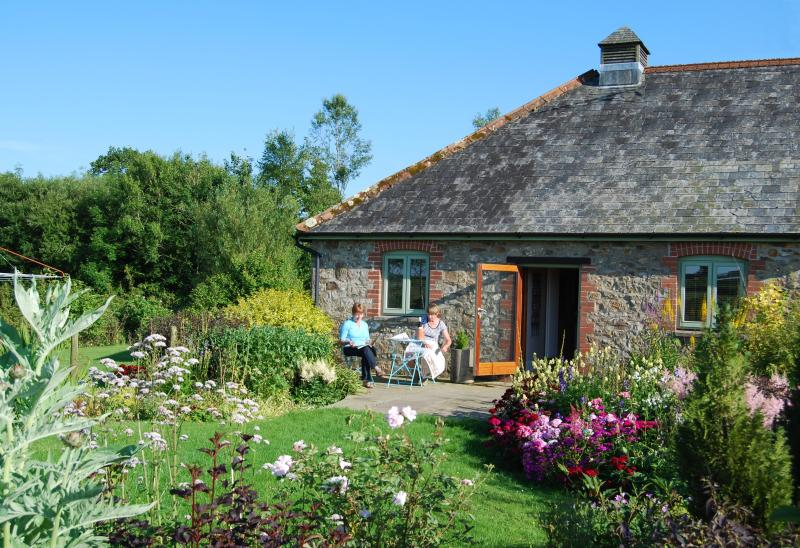 Sitting in its own secluded + very beautiful garden, here Verbena Cottage basks in the evening sun.