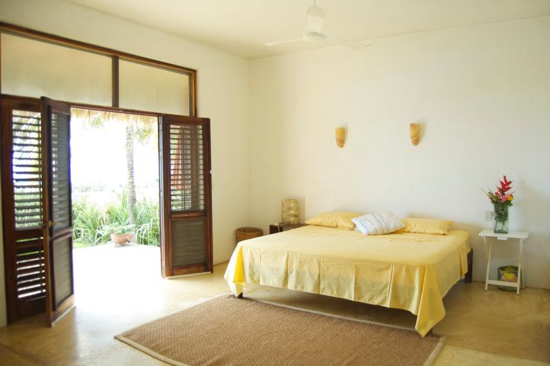 Master bedroom looks onto the ocean and palm trees, lie in bed and hear the surf..