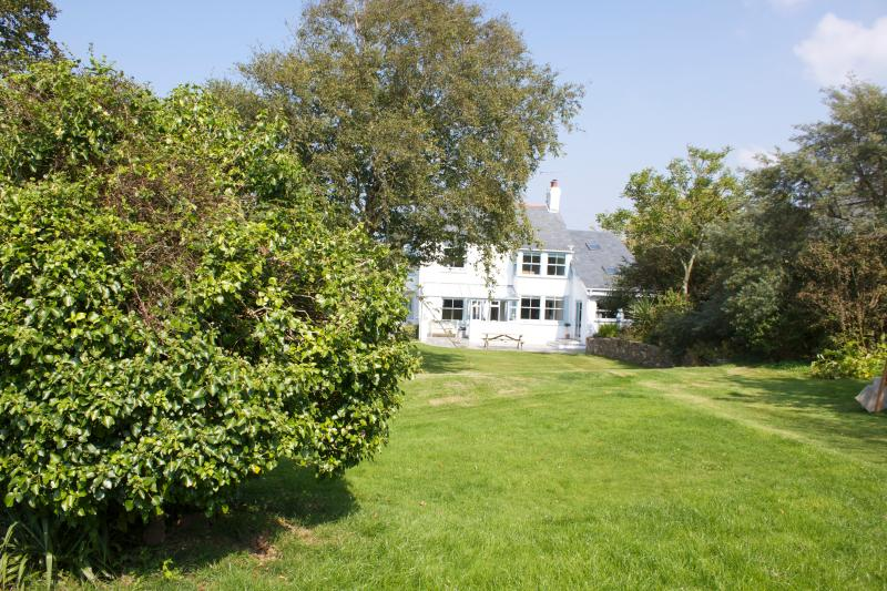 Enjoy the large family garden with trampoline, swings and dining area