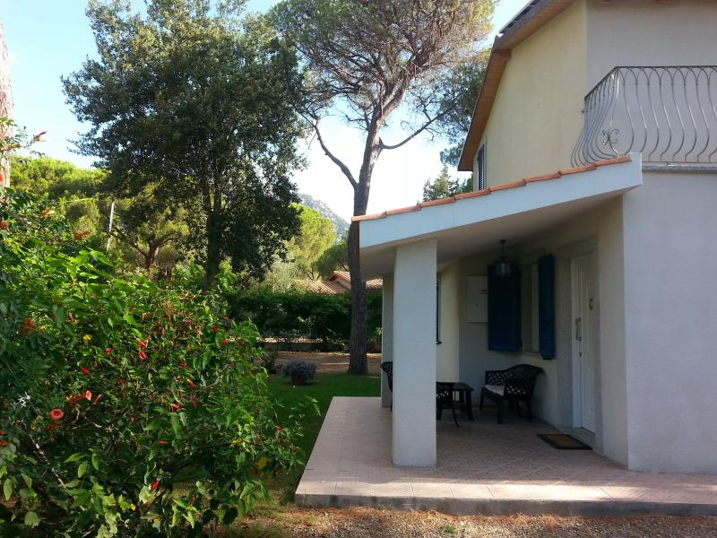 The front patio and lawn of this lovely detached house only 350m from the beach