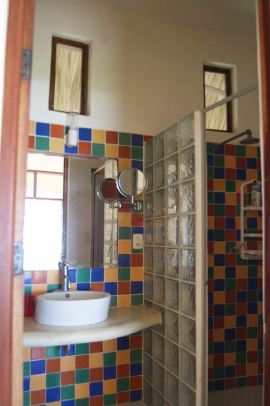 Bathrooms are decorated in tropical colours and reflect the beautiful flowers in our gardens