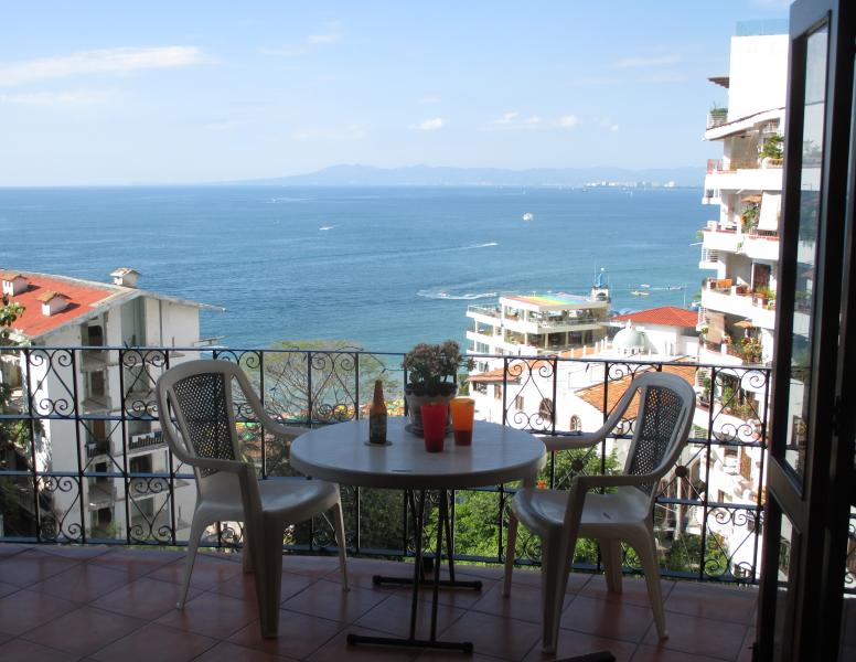 Relax on the balcony overlooking Playa de los Muertos and the Bay of Banderas