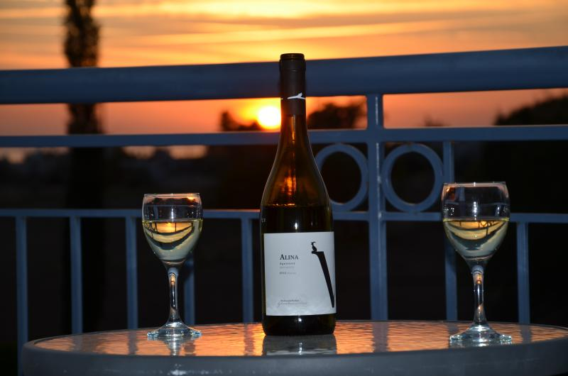 Enjoy a glass of wine and watch the sunset from the private balcony.