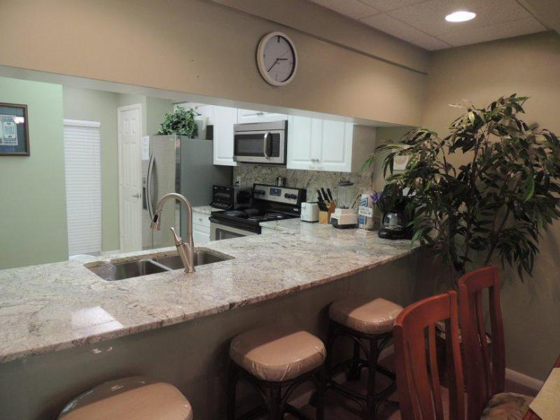 View into kitchen, new appliances, new granite tops, all new.