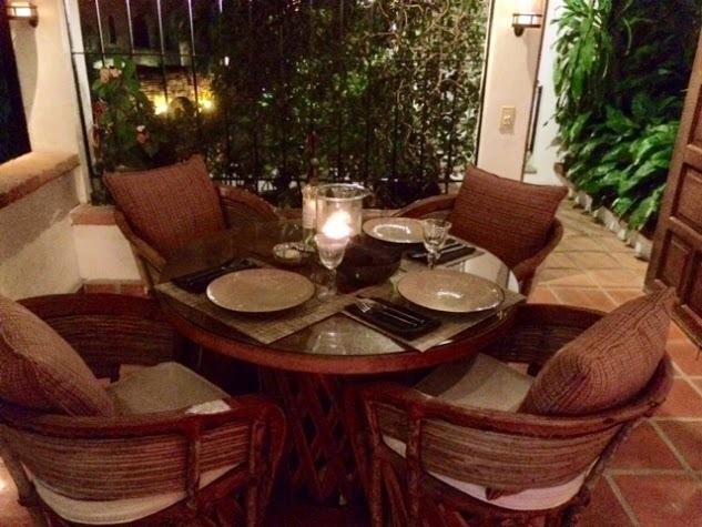 Romantic dining at night-time on the covered terrace